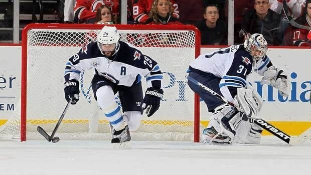 Johnny Oduya, left, had 13 points and a minus-9 rating in 63 games for Winnipeg.