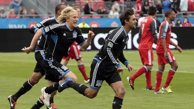 Chris Wondolowski of San Jose Earthquakes, centre, celebrates a goal against Toronto FC in at BMO Field March 24, 2012 in Toronto, Ontario, Canada.