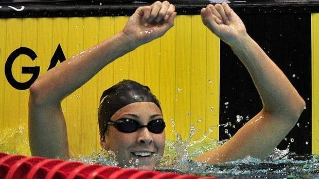 Julia Wilkinson celebrates after winning the women's 100-metre backstroke at the Canadian Olympic trials, clocking 59.85 seconds.
