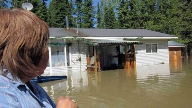 More than a dozen homes in Lower Post, B.C., were flooded in June 2012. The Yukon Department of Community Services is warning residents in the Upper Liard area to prepare for possible flooding again this year.