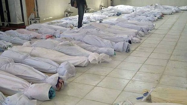 An image provided by Shaam News Network taken Saturday purports to show shrouded dead bodies following a Syrian government assault on Houla. The UN Security Council on Sunday blamed the killings on Syrian government forces.