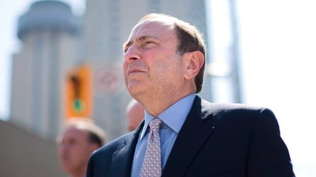 Gary Bettman, commissioner of the NHL, makes his exit after speaking with reporters following talks with the NHLPA in Toronto on Thursday, Aug. 23.
