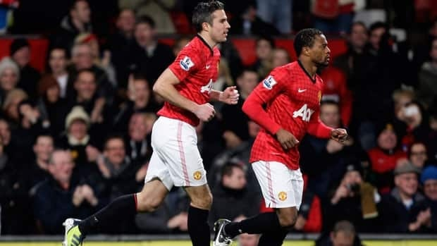 Manchester United's Robin van Persie, left, smiles after scoring against West Ham during their match at Old Trafford Stadium in Manchester, England on Wednesday.
