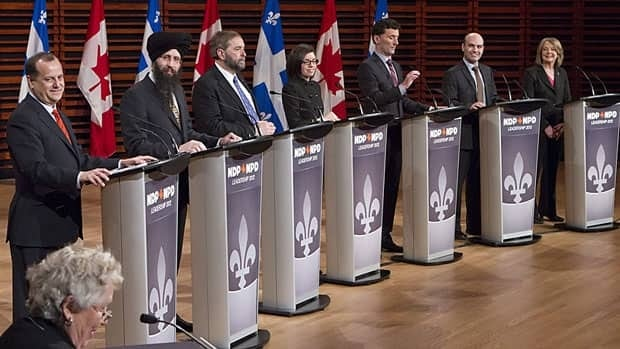 Advance online and mail-in voting for the NDP leadership convention begins Thursday afternoon. The remaining seven candidates are pictured at a debate in Quebec City on Feb. 12.