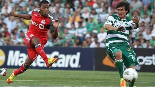 Despite scoring both goals Joao Plata, left, and Toronto FC were eliminated from the CONCACAF Champions League by Santos Laguna Wednesday night in Torreon, Mexico.