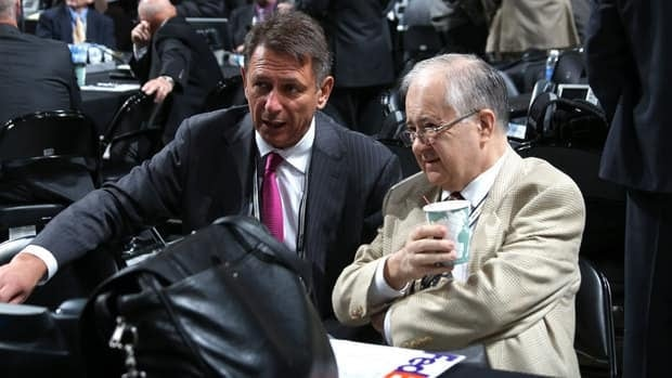 Red Wings senior vice president Jim Devellano, right, with general manager Ken Holland at the 2012 NHL Entry Draft in Pittsburgh.