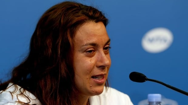 Marion Bartoli of France announces her retirement from professional tennis during the Western & Southern Open on Wednesday at Lindner Family Tennis Center in Cincinnati, Ohio.
