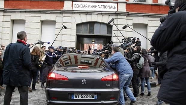 The car of Dominique Strauss-Kahn, former International Monetary Fund head, enters the Gendarmerie surrounded by the media as he arrives for questioning Tuesday by a judge investigating the so-called Hotel Carlton affair.