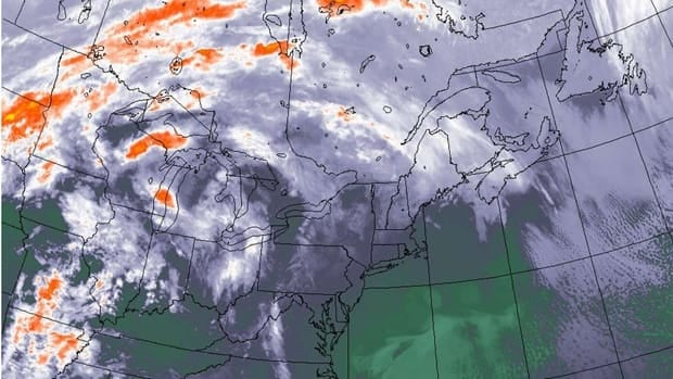 This NOAA satellite image taken Wednesday at 12:45 a.m. EST shows weather patterns over eastern Canada and the U.S. A dose of relatively-balmy weather is headed for southern Ontario and Quebec, stemming from the combination of winds circulating around a high-pressure system off the east coast, said CBC meteorologist Johanna Wagstaffe.