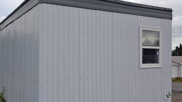 A shotgun blast damaged the RCMP detachment in Postville.