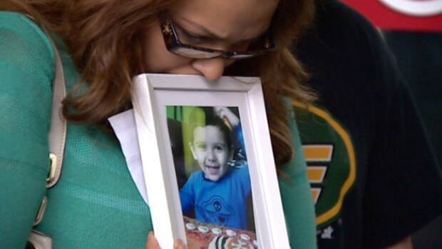 Sage Morin cradles a photo of her two-year-old son Geo outside the Edmonton courthouse in 2013 after his accused killer was granted bail.