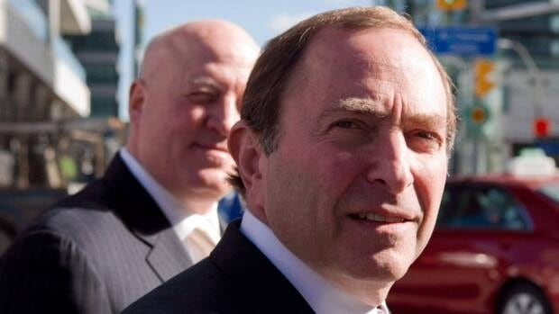 NHL Commissioner Gary Bettman, right, arrives with deputy commissioner Bill Daly for collective bargaining talks in Toronto on Wednesday October 16, 2012.