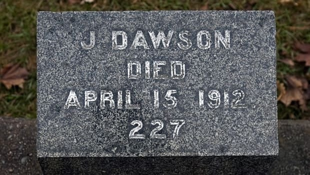 The grave marker of J. Dawson, a victim of the Titanic disaster, rests in Fairview Lawn Cemetery in Halifax. The stone marks the resting place of Joseph Dawson, but after a the Titanic moview was released with a character named Jack Dawson, the modest grave became a pilgrimage site for Titanic devotees the world over.