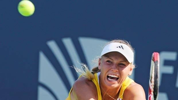 Caroline Wozniacki of Denmark, hits a backhand during action Wednesday at the New Haven Open tennis tournament.