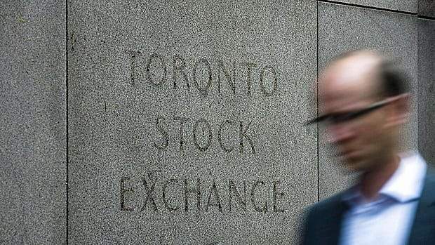 A man walks past a building in Toronto that used to house the Toronto Stock Exchange. The TSX was sharply higher on Thursday.