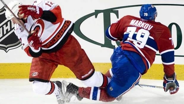 Carolina Hurricanes' Eric Staal, left, collides with Montreal Canadiens' Andrei Markov during a game on Nov. 13, 2010. Markov has missed the majority of the last two seasons due to recurring knee injuries.