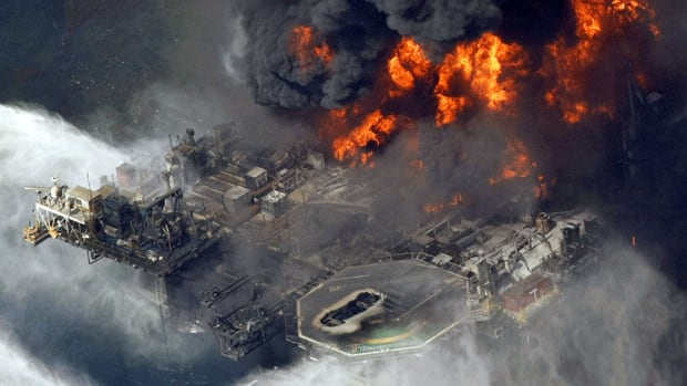 A file photo from April 21, 2010, shows the Deepwater Horizon oil rig burning in the Gulf of Mexico. BP has accepted $250 million from Cameron International, the company that manufactured the blowout preventer that failed to contain the oil, following the accident that claimed 11 lives.
