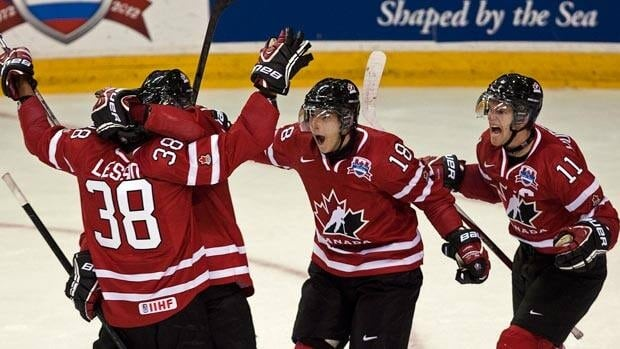 Canada's Lucas Lessio, left, celebrates his goal with teammates Ryan Strome, centre, and Jonathan Huberdeau, right, during Tuesday's game at the Metro Centre.