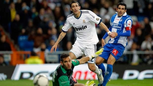 Real's Angel Di Maria from Argentina scores a goal against Alcoyano during a Copa del Rey soccer match at the Santiago Bernabeu stadium in Madrid.