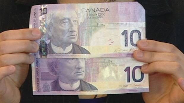 A fake bill, below, is shown next to a real one. This one and others like it have been turning up in Iqaluit this week. The fake bills look and feel just like real ones, but are missing some key parts.