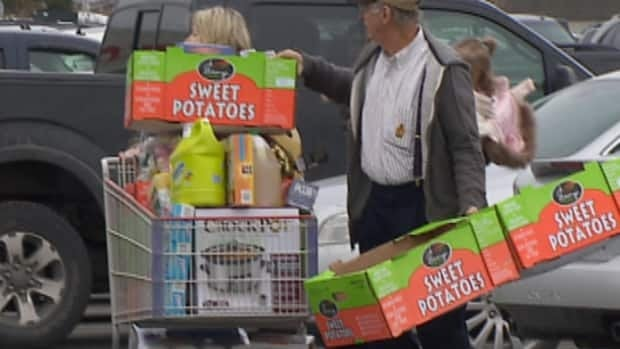 Shoppers in a big box store parking lot in St. John's on Dec.20.