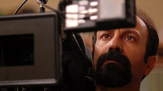 Iranian filmmaker Asghar Farhadi looks at the playback of a scene from his movie A Separation, which won the best foreign language film Oscar.
