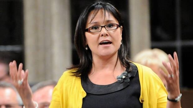 Health Minister Leona Aglukkaq was interrupted by two doctors voicing concerns about the recent cuts to refugee health during a research funding announcement in Hamilton, Ont., on Thursday.