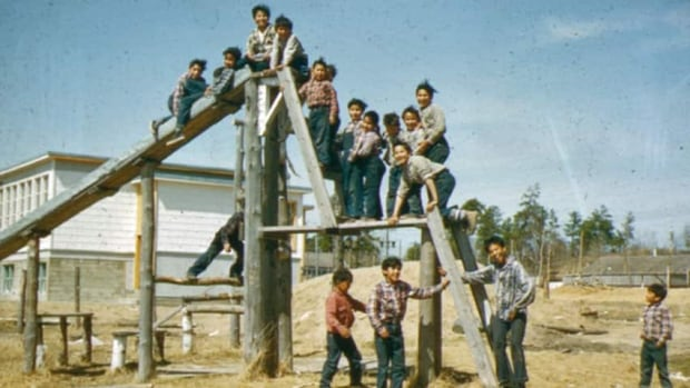 The smiling faces in this archival photo from the Presbyterian Church in Canada belie the fact the school had a chronic problem with runaways. Twelve children ran away on the day Charlie Wenjack made his escape in October 1966.
