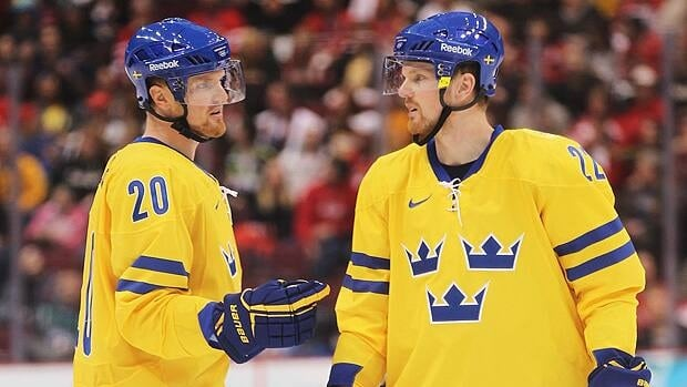 Henrik Sedin, left, and brother Daniel weren't able to help Sweden reach the podium in their NHL city's rink at the 2010 Olympics.
