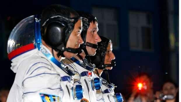 From left: Japanese astronaut Akihito Hoshide, Russian cosmonaut Yuri Malenchenko and American astronaut Sunita Williams get ready for the launch of a Soyuz-FG rocket at the Russian-leased Baikonur cosmodrome in Kazakhstan on Sunday.