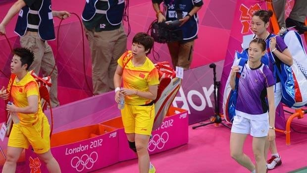 Wang Xiaoli and Yang Yu of China, right, leave the court with Ha Na Kim and Kyung Eun Jung of South Korea after their widely panned badminton match on Tuesday.