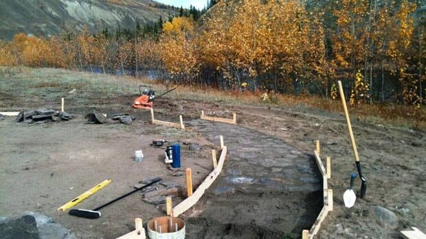 The Ross River Dena Council is building a permanent prayer circle at the Old Ross site with a central fire pit and a memorial plaque bearing the names of those sent to residential school.