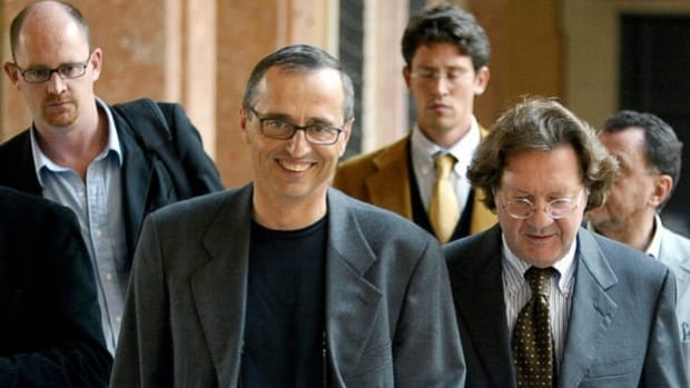 Dr. Michele Ferrari, middle, denies being the doping mastermind for cyclist Lance Armstrong.