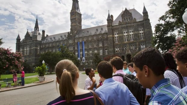 Students tour Georgetown University's campus in Washington. D.C. An HSBC study found foreign student fees in Canada are competitive.