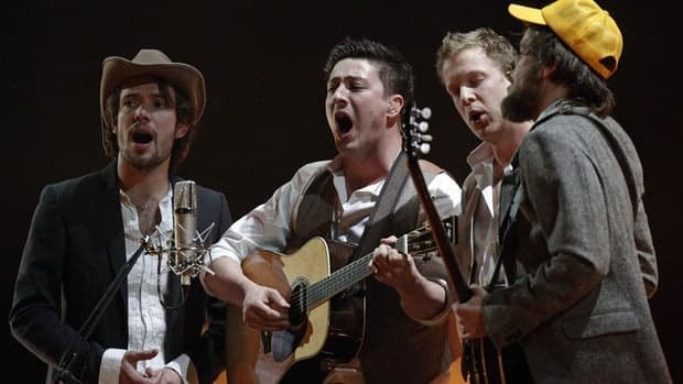 Mumford & Sons perform on stage during the BRIT music awards at the O2 Arena in London on Feb. 15, 2011.   From left, Ben Lovett, Marcus Mumford, Ted Dwane and Country Winston Marshall.