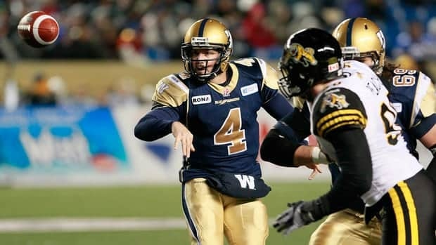 Winnipeg Blue Bombers' Buck Pierce (4) tosses out the lateral during the first half Friday against Hamilton Tiger-Cats.