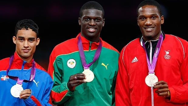 Sprinter Kirani James, centre, has made the tiny Caribbean country of Grenada proud with his win in the 400 metres. Grenada, with a population of a little more than 100,000, sent just nine athletes to London.