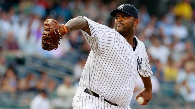 CC Sabathia of the New York Yankees in the first inning against the Toronto Blue Jays at Yankee Stadium.