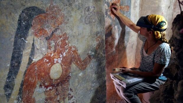 A conservator cleans and stabilizes the surface of a wall of a house that dates to the 9th century in the Maya city Xultun in northeastern Guatemala. Archaeologists found the small room where scribes apparently used walls like a blackboard to keep track of astronomical records.