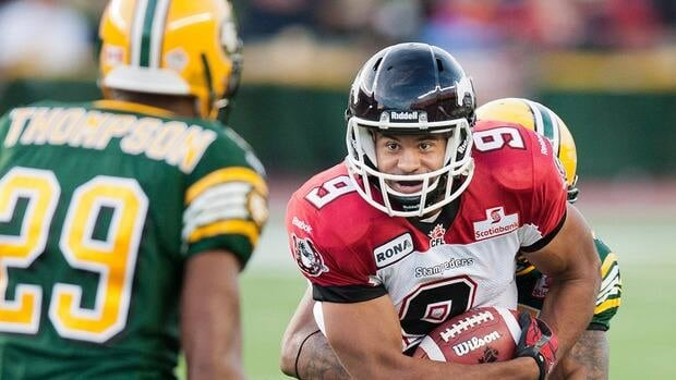 Stampeders running back Jon Cornish (9) scored on a 59-yard touchdown run with five minutes remaining to give Calgary another victory over the Eskimos Friday night in Edmonton.