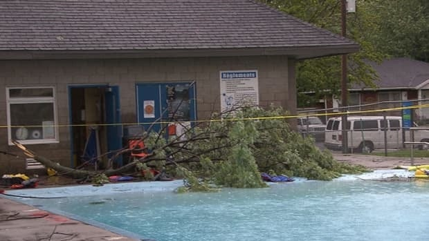 Two people were injured and one person was killed after high winds caused a tree branch to fall at a Boucherville pool.