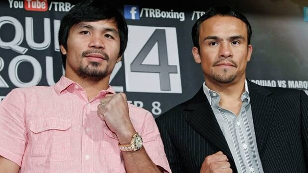 Manny Pacquiao, left, and Juan Manuel Marquez pose at Monday's press conference to make their fourth fight official.