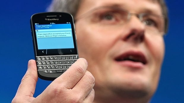 BlackBerry CEO Thorstein Heins shows off the Q10. Chinese company Lenovo is reported to be considering a bid for BlackBerry.