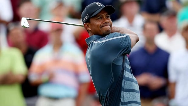 Tiger Woods suffered back spasms while playing last week's event, The Barclays, in which he finished in a tie for second.