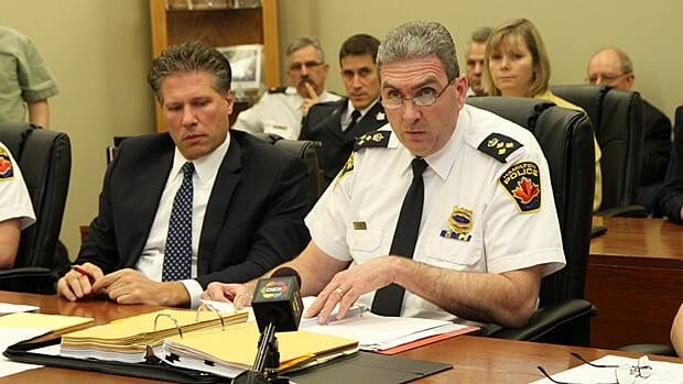 Chief Glenn De Caire (right), with legal counsel Marco Visentini, seen in 2013 at a budget review meeting. Visentini opined last week that a board motion crossed the line into meddling in the day-to-day operations of the service.