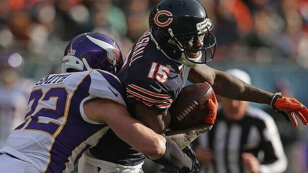 Vikings strong safety Harrison Smith, left, suffered a concussion in the second half of Sunday's game at Chicago.