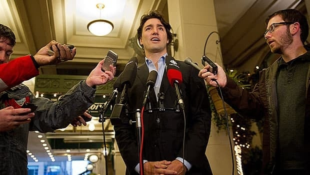 Liberal MP Justin Trudeau speaks to reporters outside a hotel in Vancouver Friday, where he offered an apology for comments he made about Alberta politicians in 2010.
