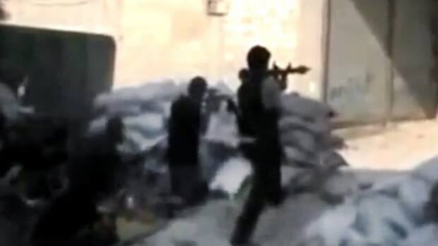 Free Syrian Army soldiers clash with Syrian government forces in Damascus in this image made from unverified amatuer video on Sunday.
