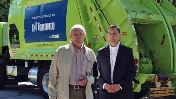Progressive Conservative candidate Doug Holyday and Party Leader Tim Hudak held a press conference on Wednesday in front of a City of Toronto-contracted garbage truck.