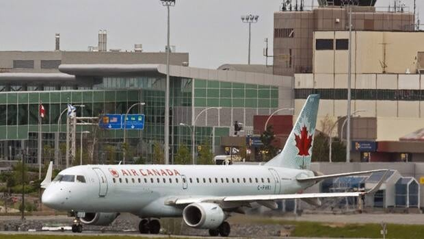 An Air Canada jet lands at the airport in Halifax on Friday, June 10, 2011. The company's baggage handlers, ground crews and maintenance workers have a rejected a tentative contract deal.